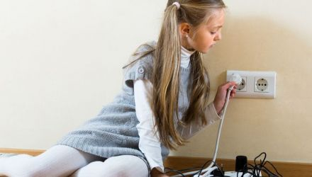 Little girl dangerously playing with sockets and electricity while her parents absent
